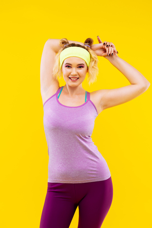 Feeling energized. Cheerful blonde-haired woman feeling energized after sport in the morning Stock Photo