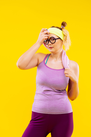 Feeling exhausted. Young blonde-haired woman feeling exhausted after long tiring time at gym