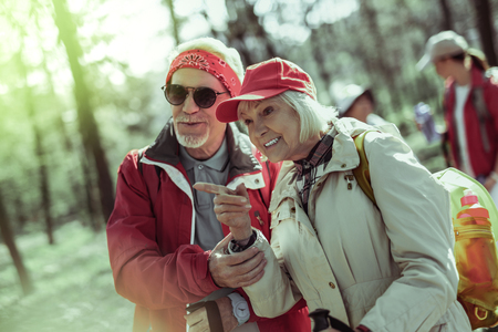 Interesting walks. A couple os seniors noticing animals in the forest