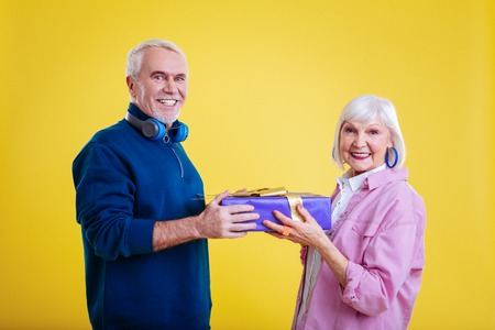 After receiving present. Retired couple feeling happy and thankful after receiving present in a box Imagens