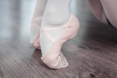 Dancing position. Close up of a female feet standing on the toes while dancing Stock Photo