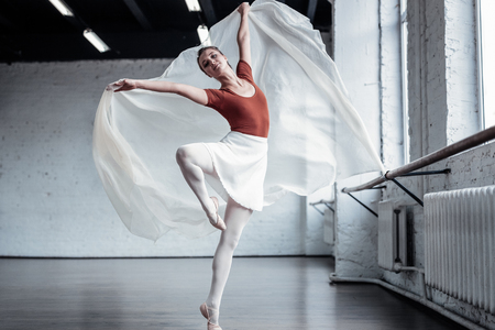Ballet dance movements. Nice good looking woman showing pirouettes while dancing