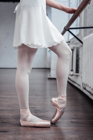 Dancing position. Close up of ballerinas legs being in special position Zdjęcie Seryjne