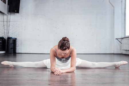 Perfect flexibility. Nice good looking woman working hard while practicing her splits Stockfoto