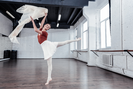 No frames. Beautiful young ballet dancer feeling freedom while performing her dance Imagens