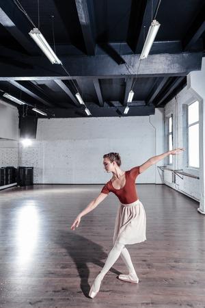 My passion. Nice attractive ballerina enjoying her ballet dance while practicing in the dance studio Imagens