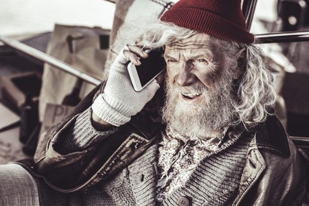 Not that bad. Old dirty almsman finding new phone and deciding to call to someone while waiting for strangers with alms.
