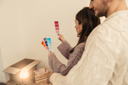 Choosing colors. Just married couple choosing colors for their house while making renovation