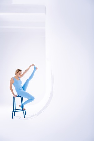 Beautiful movements. Professional female gymnast having her training while working on her skills
