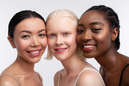 Women power. Three women with different skin smiling while thinking about women power