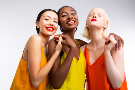 Women posing. Stylish women with different skin color posing for diverse and equality photo shoot