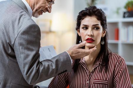 Enduring flirt. Shameless unpleasant senior boss touching his female worker while she suffering under his hands