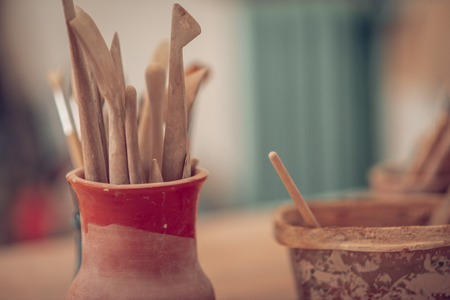 Wooden sticks. Close up of special wooden instruments being used in the workshop Imagens