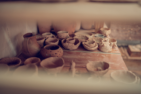 Handmade objects. Top view of a shelf with dishes from clay lying on it