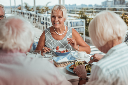 City views. Cute blonde keeping smile on her face while enjoying time with her family Stock Photo - 124983567