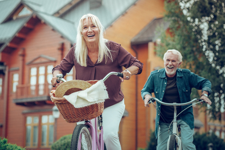 This is our hobby. Joyful happy couple having fun while riding bikes together Stock Photo - 124984613