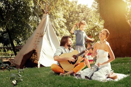 Our hobby. Joyful nice people playing their favourite music while enjoying being outdoors Reklamní fotografie
