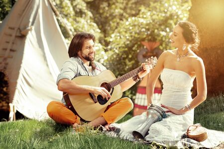 Great mood. Nice happy couple looking at each other while playing music together