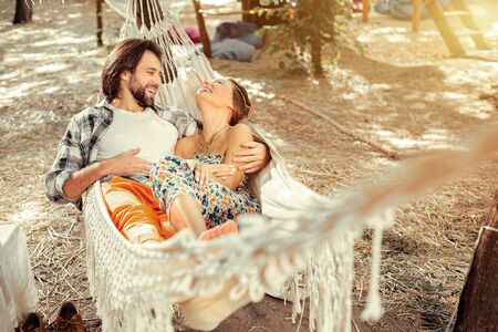 Romantic time. Positive joyful couple being in a great mood while being together with each other
