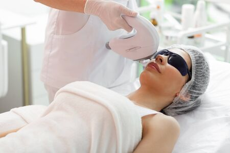 Laser epilation. Beautiful mature woman having a special laser procedure while visiting a beauty clinic