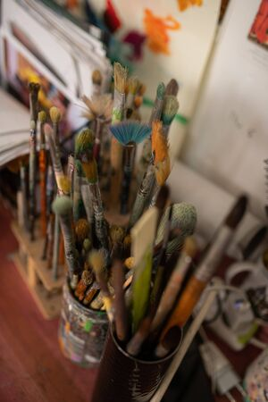 Varied brushes. Top view of varied professional painting brushes of famous artist standing on the table Archivio Fotografico