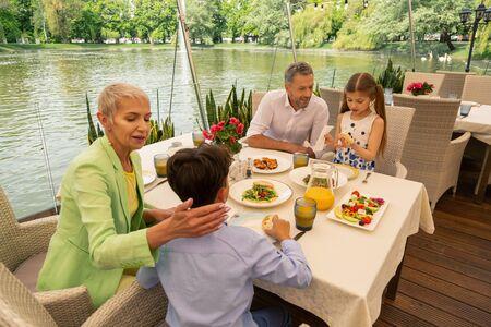 Children eating. Children eating yummy bruschetta with their grandparents for breakfast