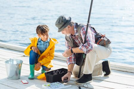 Grandson feeling excited. Handsome cute grandson feeling excited before fishing with grandfather Stockfoto