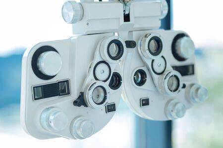 Professional device. Close up of a lens optical instrument being used for eyesight testing