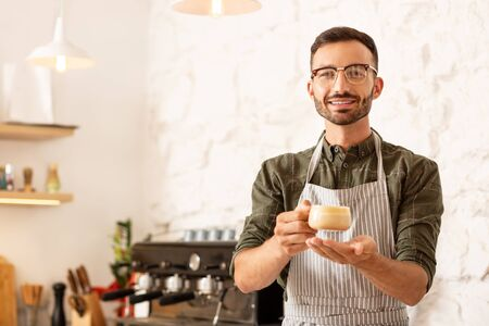 Businessman feeling happy. Handsome businessman feeling happy while making coffee in his own coffee shop Stok Fotoğraf