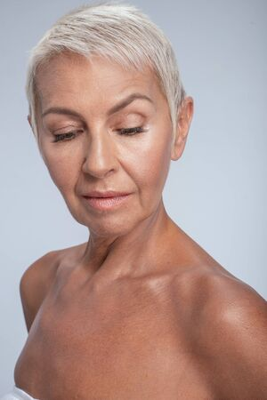Close up of an attractive middle aged lady looking down posing Stok Fotoğraf
