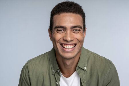 Good-looking young male with dimples on his cheeks having fun