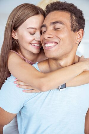 Love you. Happy international man keeping eyes closed and demonstrating his smile 版權商用圖片