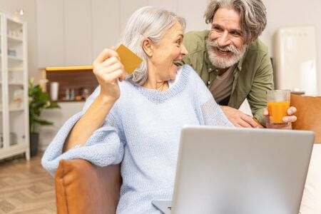 Man and a lady with a laptop laughing heartily