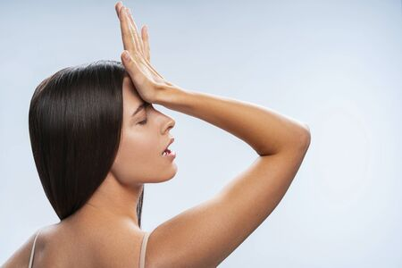 Sexy lady touching her forehead. Beauty and health concept Stock Photo