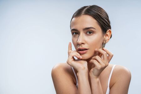 Cute young lady takes care of her beauty. Beauty procedures concept