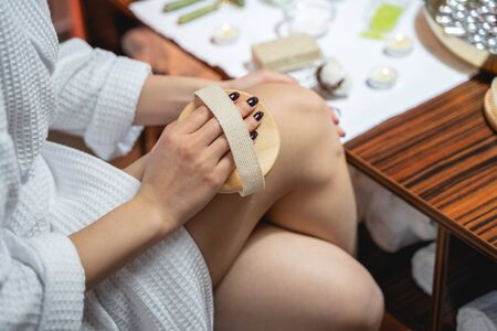 Asian cute woman takes care of her legs. Massage concept