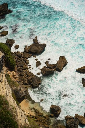 Mighty ocean water flowing and crushing into rocky cliff stock photo Reklamní fotografie