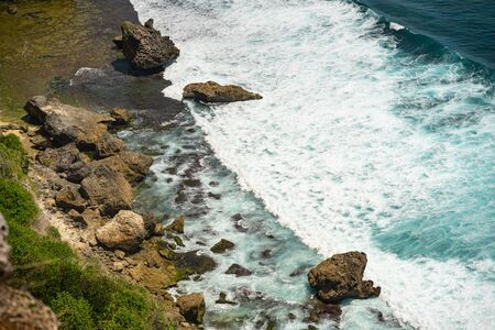 Magnificent view of ocean waves breaking against rocky shore stock photo