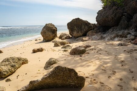 Exotic deserted beach with greenery and rocks on island Reklamní fotografie
