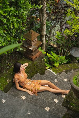 Pretty brunette female person enjoying exotic sounds of nature while spending her vacation on Bali