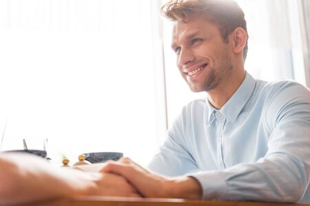 Handsome gentleman in shirt sharing tender moment with his girlfriend and smiling. Website banner Фото со стока