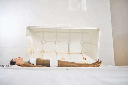 Young woman with nourishing body mask on her skin lying in a spa capsule with closed eyes