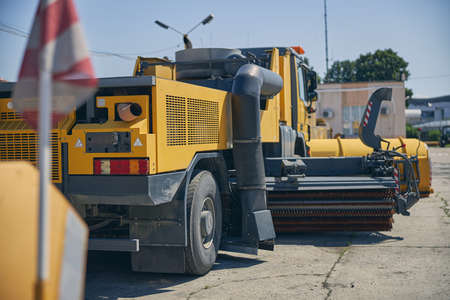 Close up of big unit being in use during work on the territory of airport