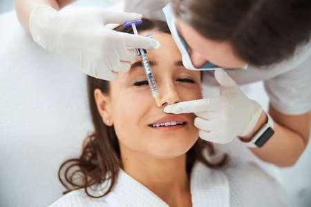 Beauty salon customer undergoing a mesotherapy procedure