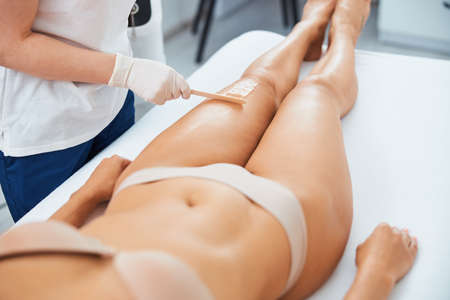 Cosmetologist cleansing the woman skin after a laser hair removal