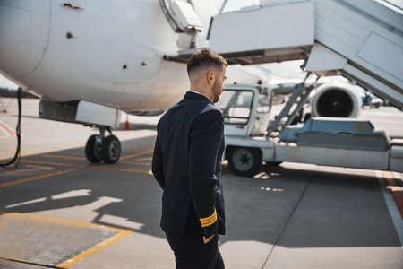 Pilot walking away to airstairs of aircraft