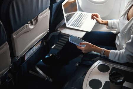 Unrecognized female passenger using the Internet in the plane