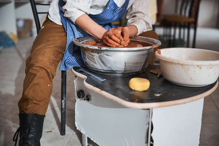 Close up of professional potter shaping clay vase