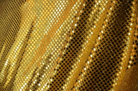 Golden fabric clothing, luxury textures photo