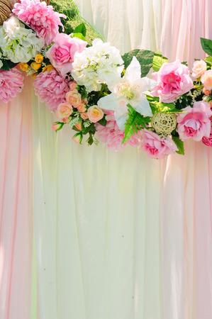 Vertical romantic wedding scene pink background Stock Photo